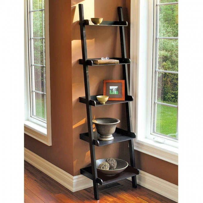 Black Wooden Ladder Bookshelf On Wooden Floor Matched With Brown Wall Plus White Baseboard Molding Plus White Window For Living Room Decor Ideas