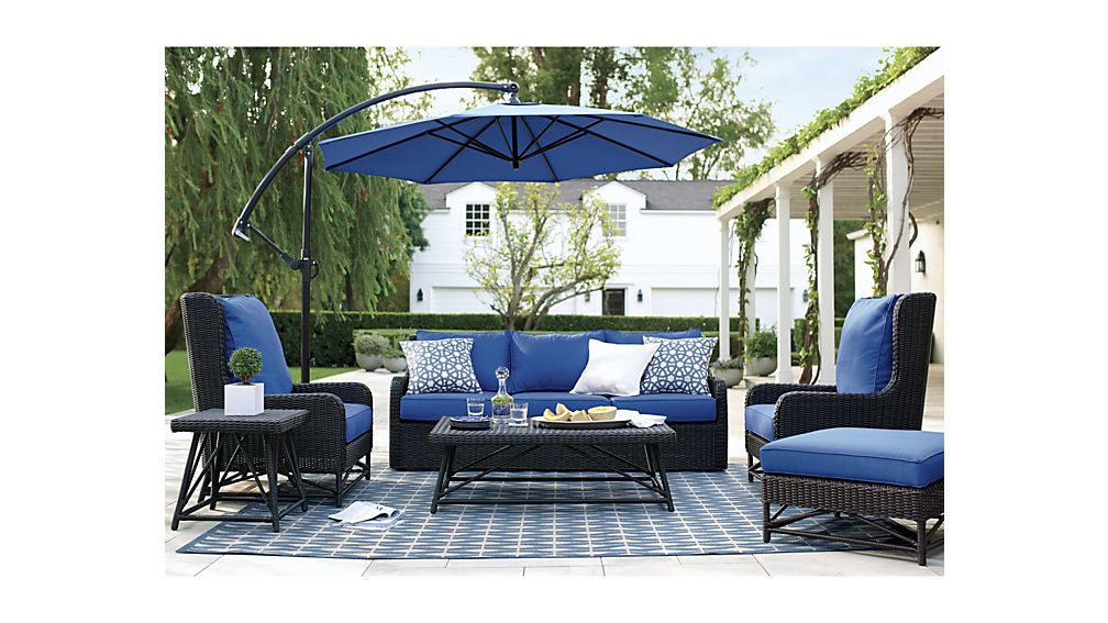 blue cantilever patio umbrella with black stand with sofa in blue theme for patio decor inspiration
