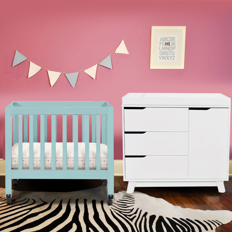 blue crib by babyletto on wooden carpet plus zebra pattern carpet plus white cabinets for nursery decor ideas
