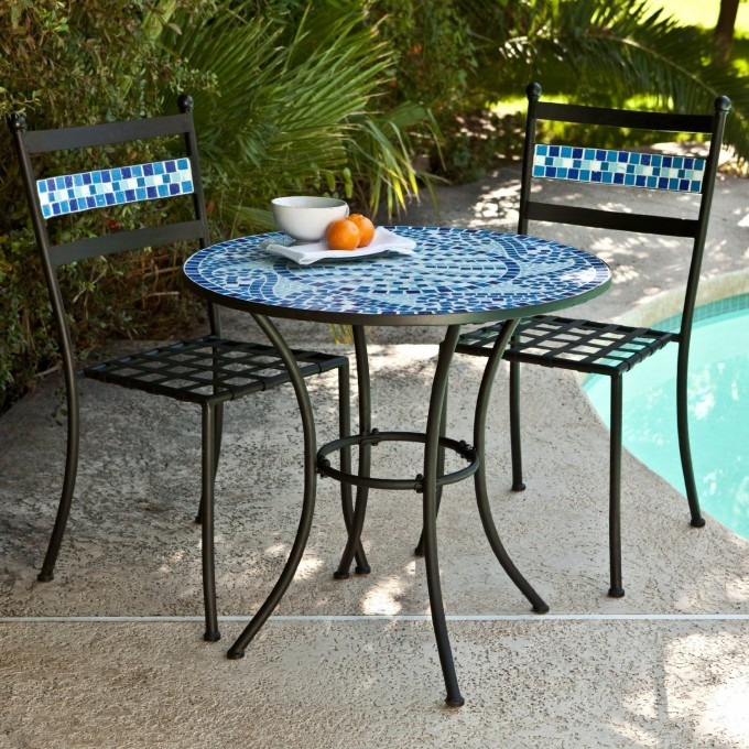 Blue Mosaic Bistro Table With Black Legs And Double Chairs Near The Swimming Pool For Patio Decor Ideas