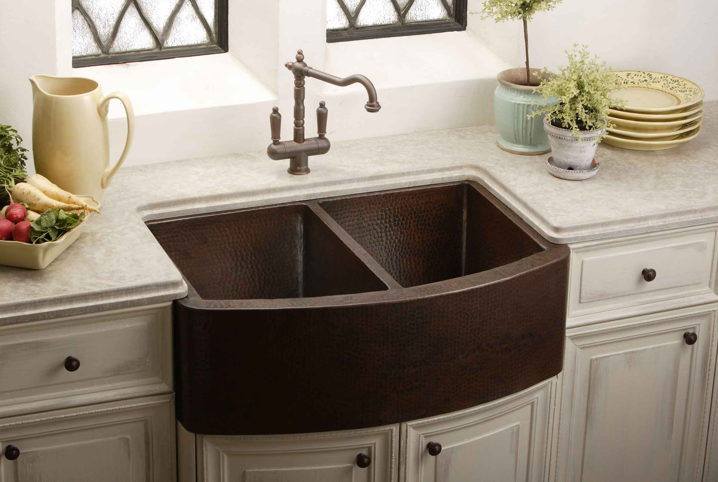 brown apron sink on white wooden kitchen cabinet with countertop and faucet bridge for kitchen decor ideas