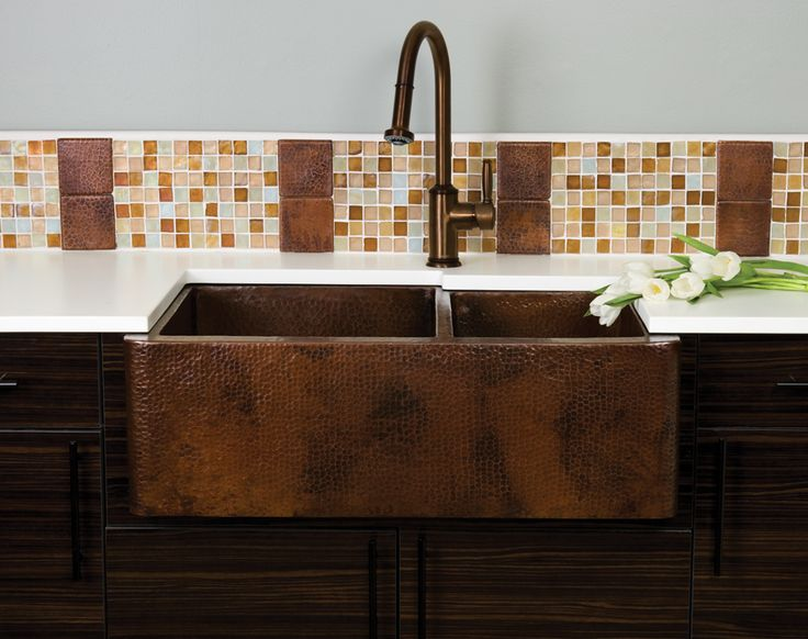 brown apron sink with double spaces plus brown faucet on kitchen cabinet with white countertop for kitchen decor ideas