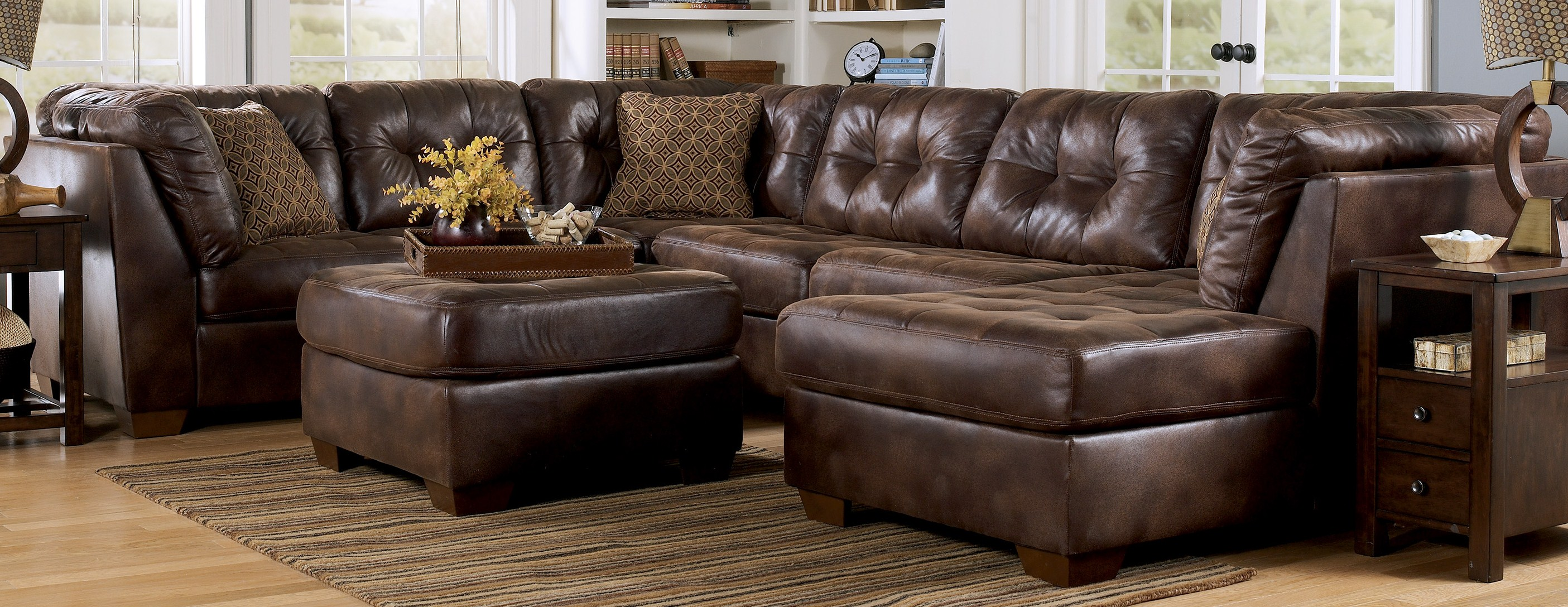 Brown Leather Sectional Sleeper Sofa Plus Ottoman On Brown Carpet For Living Room Decor Ideas