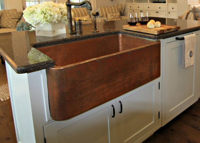 Brown Rectangle Apron Sink On White Kitchen Cabinet With Faucet And Black Countertop For Kitchen Decor Ideas
