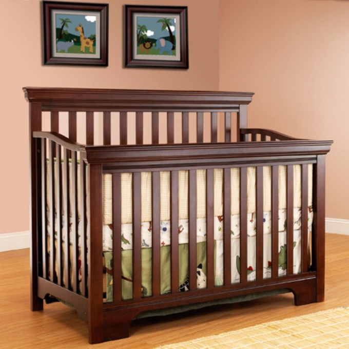 Brown Wooden Munire Crib On Wooden Floor Plus Cream Carpet Matched With Salmon Wall For Nursery Decor Ideas