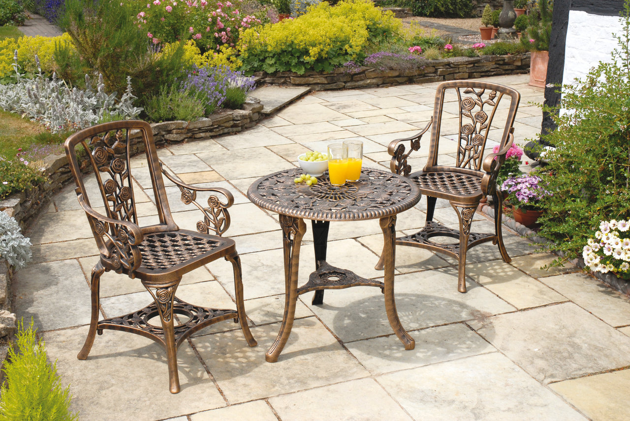 burly wood mosaic bistro table on tile floor for patio decor ideas