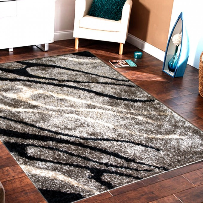 Charming 5x7 Area Rugs On Wooden Floor Plus Single Sofa For Living Room Decor Ideas