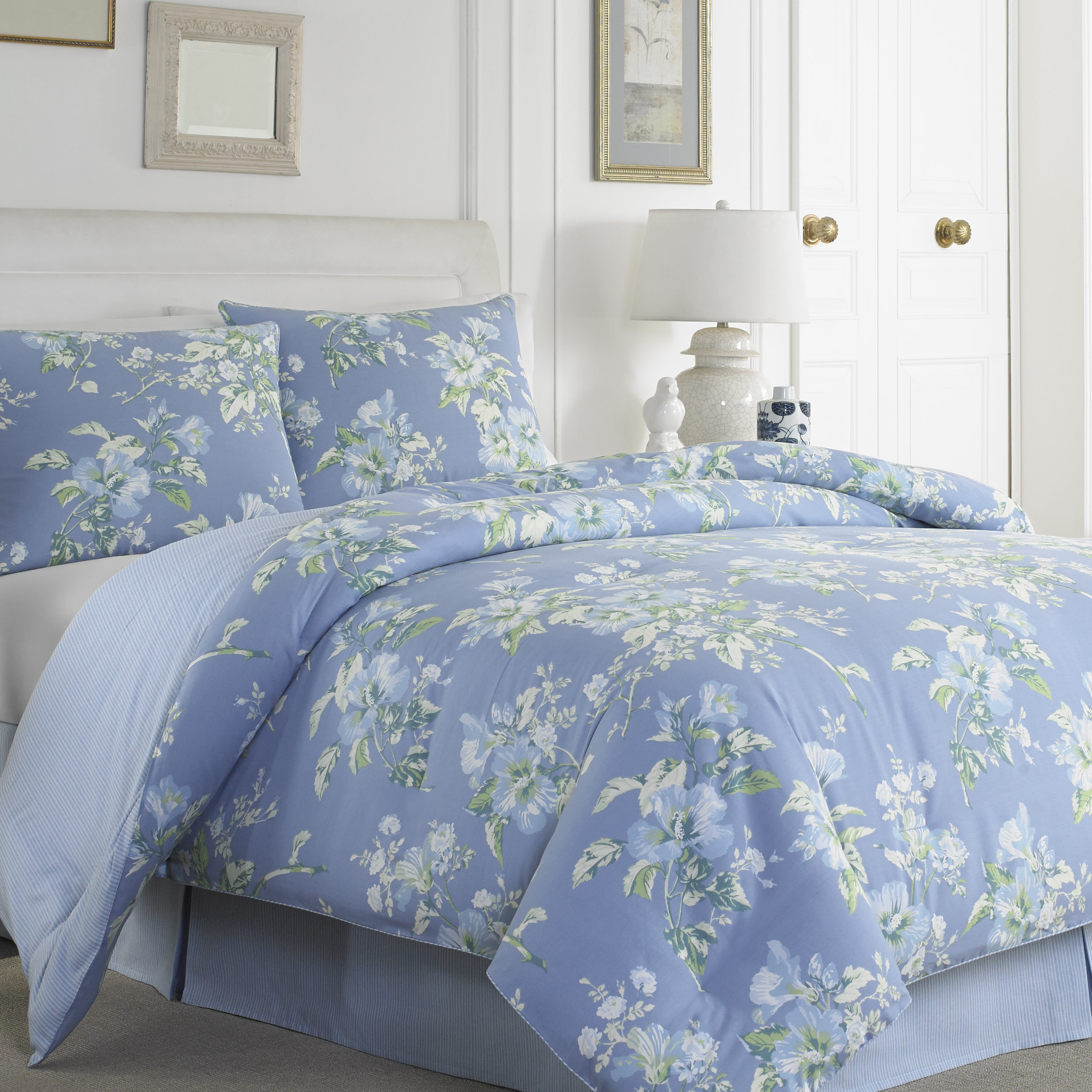 charming bedding in blue and floral pattern by laura ashley bedding with white headboard on wheat floor matched with white wall plus table standing lamp for bedroom decor ideas