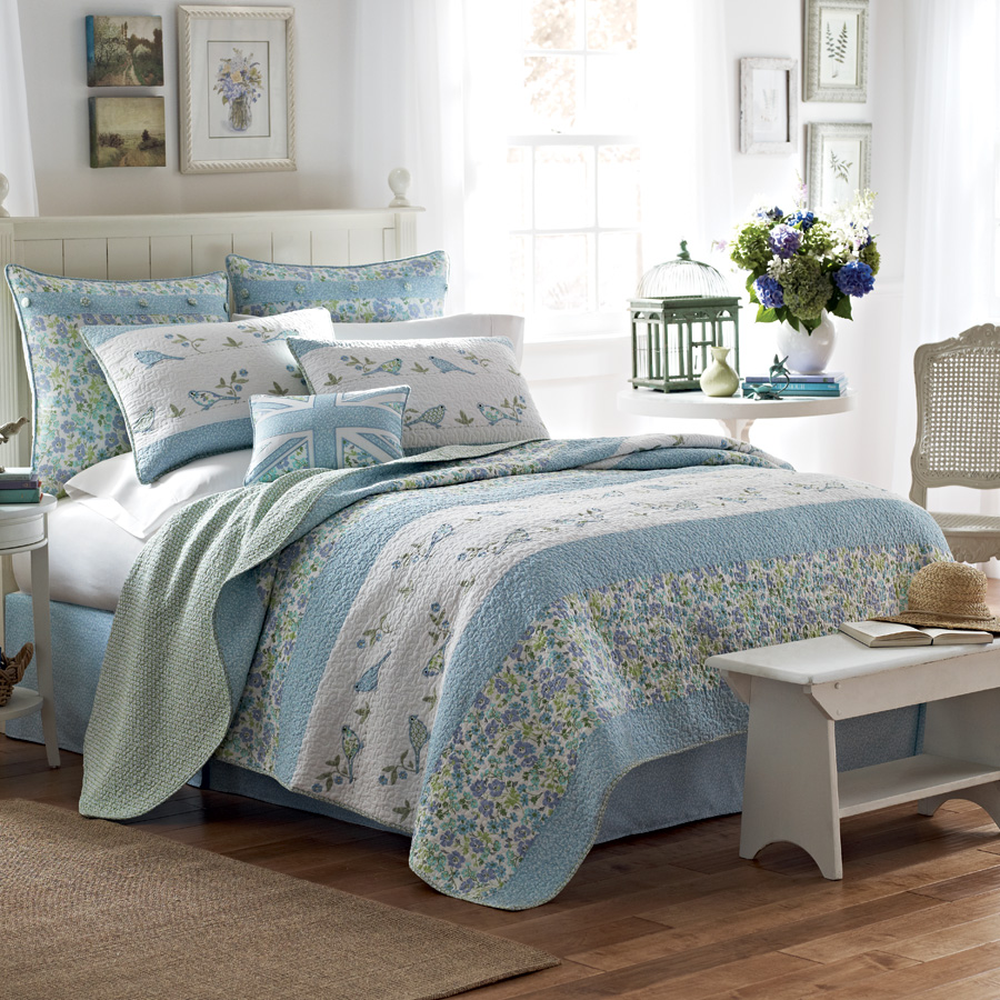 charming bedding in blue and floral theme by laura ashley bedding on wooden floor plus brown carpet matched with white wall plus white window for bedroom decor ideas