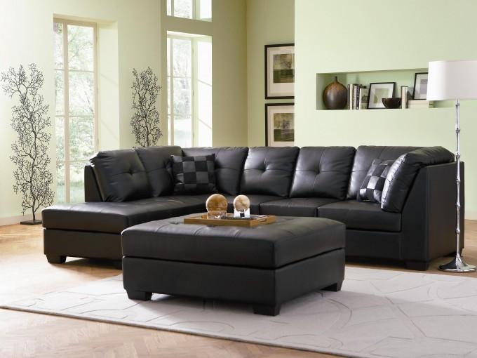 Charming Black Leather Cheap Sectional Sofas On Wooden Floor Plus Black Ottoman And White Carpet For Living Room Decor Ideas
