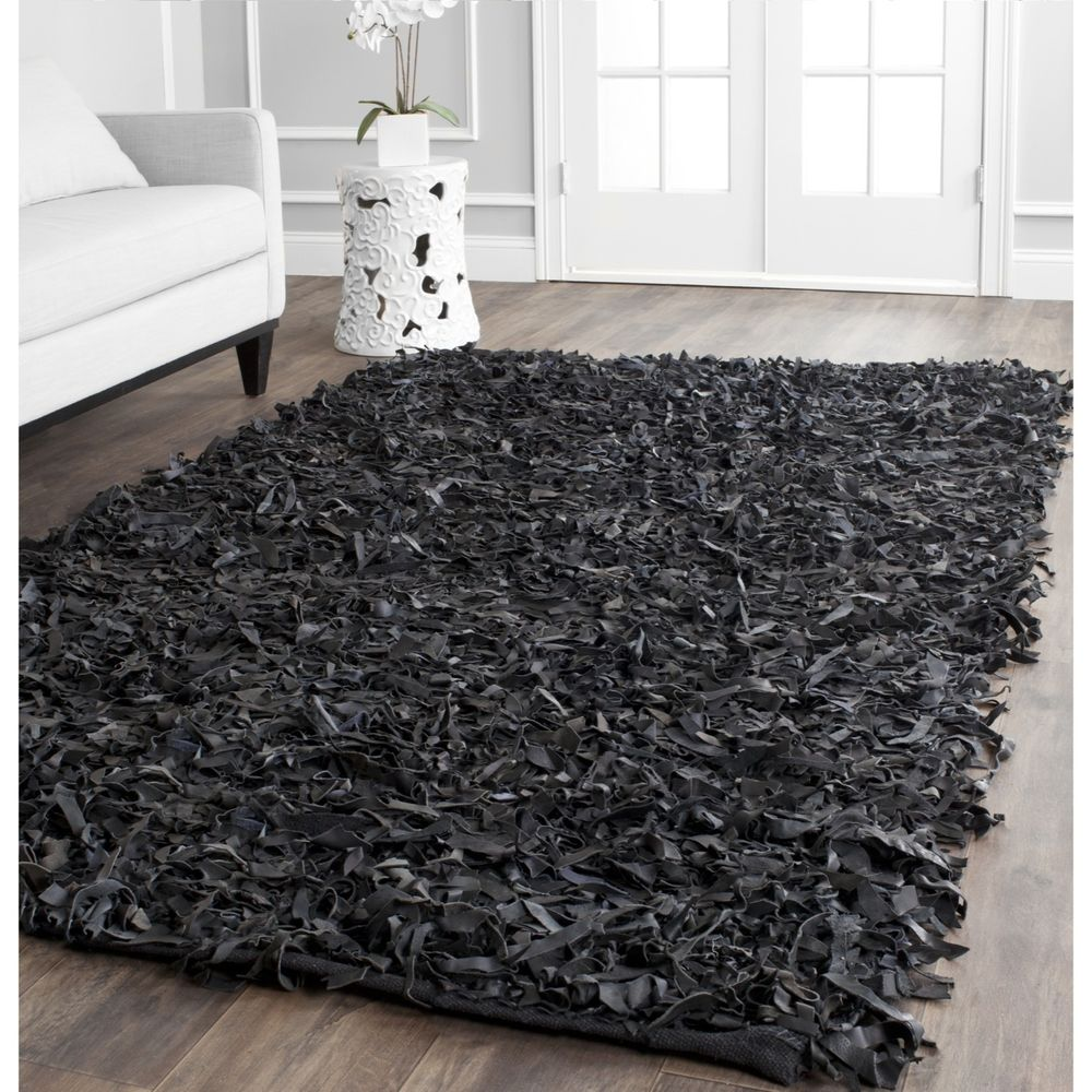 charming black shag rugs on wooden floor plus black sofa for living room decor ideas