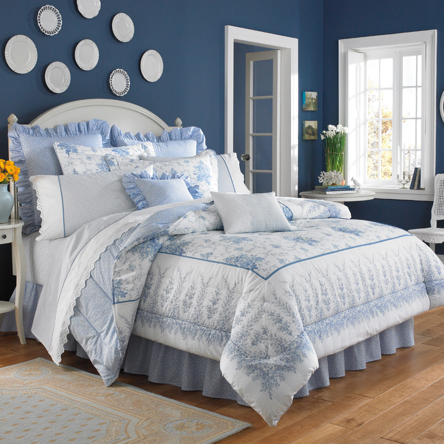 charming blue and floral laura ashley bedding with white headboard plus pillows on wooden floor plus rectangle rug matched with blue wall plus white door and window for inspiring bedroom decor ideas