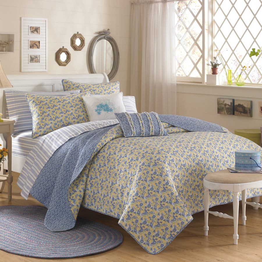 charming blue cream and floral pattern laura ashley bedding with white headboard and pillows on brown wooden floor plus blue tug matched with cream wall plus white curtains for bedroom decor ideas