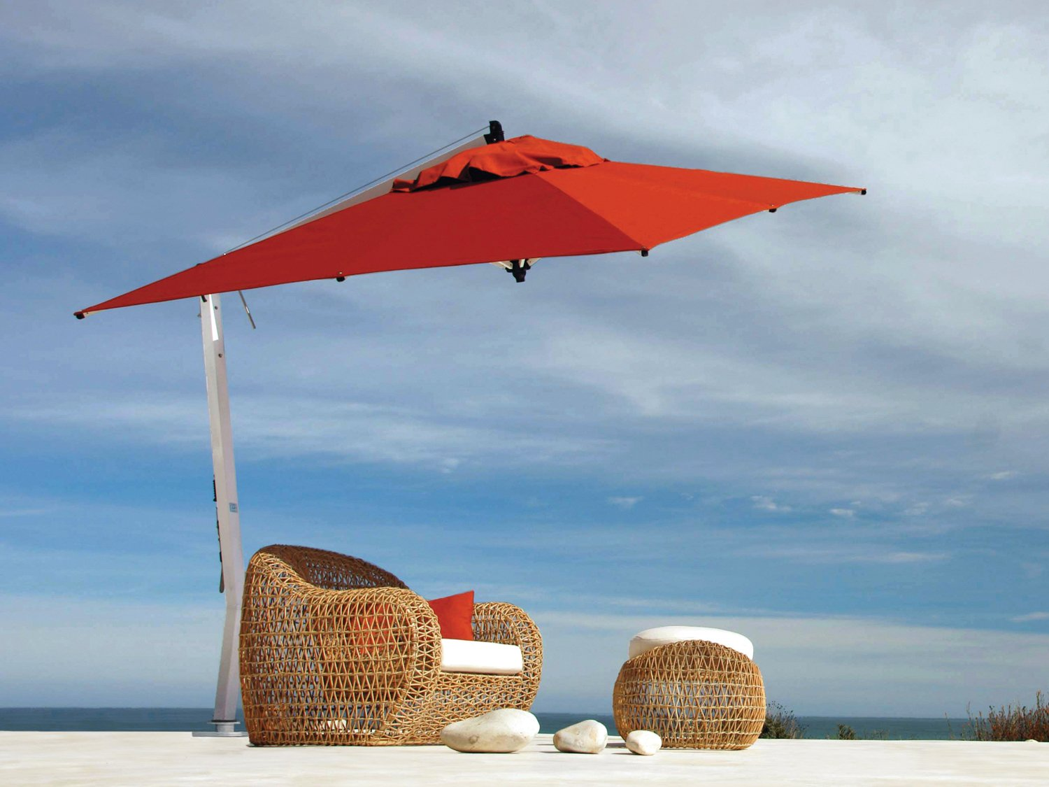 charming cantilever patio umbrella in red with white metal stand plus rattan sofa for inspiring patio decor ideas