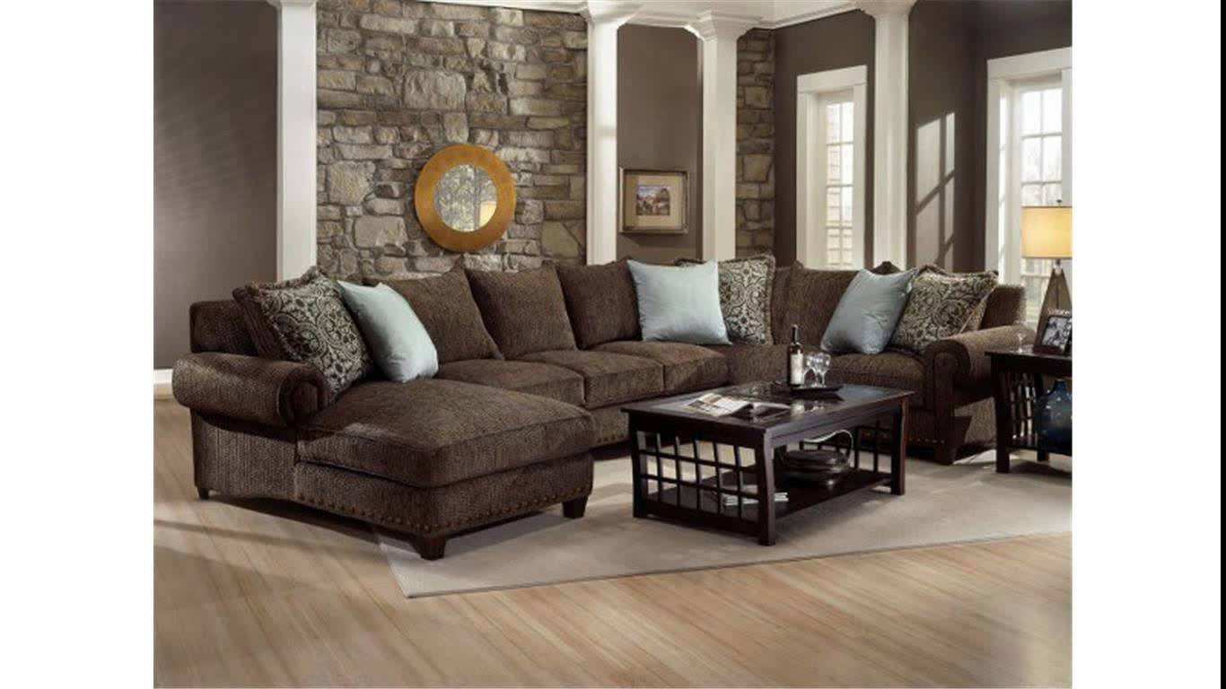 charming cheap sectional sofas in brown on wooden floor plus wheat carpet plus black table and natural stone wall for living room decor ideas