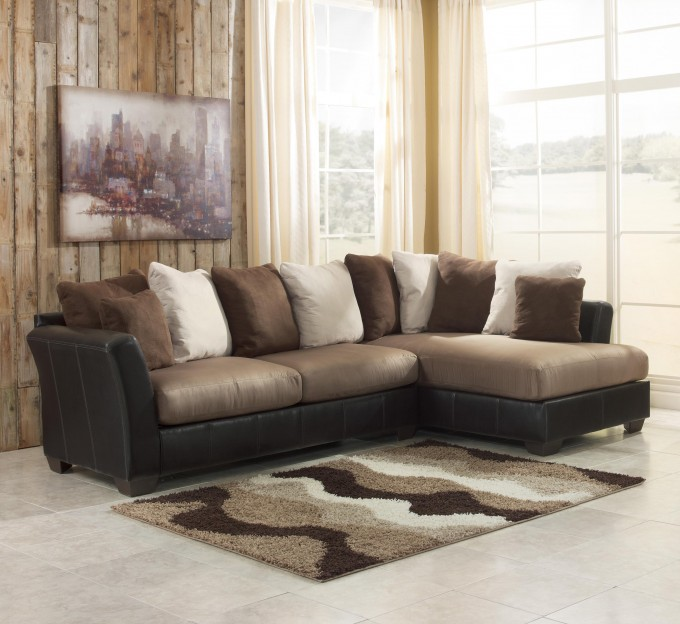 Charming Cheap Sectional Sofas In Tan And Black On White Ceramics Floor Plus Waves Pattern Of Rug For Living Room Decor Ideas