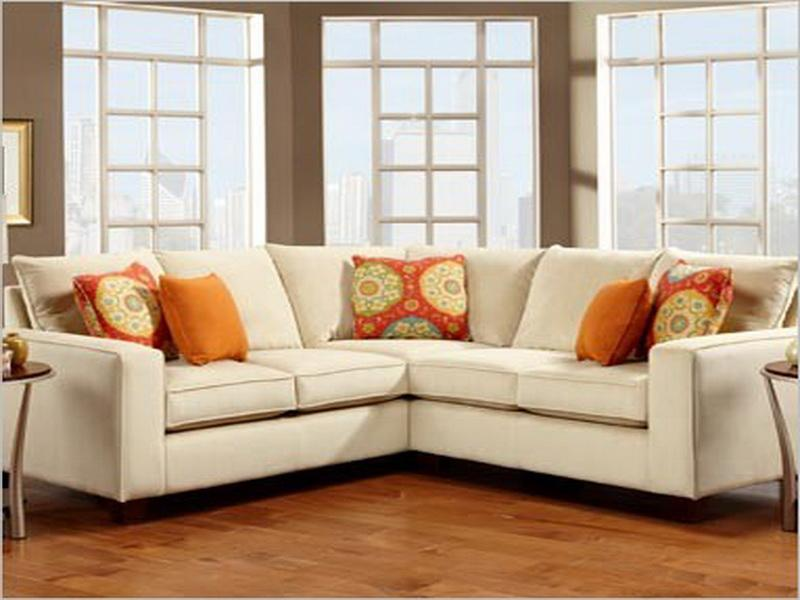 charming cheap sectional sofas in white plus cushions on wooden floor matched with tan wall for living room decor ideas