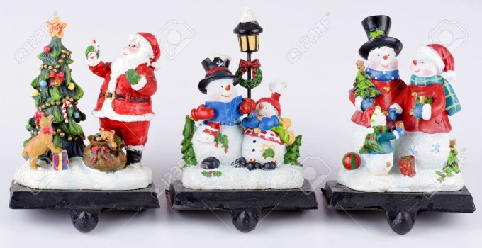 Charming Christmas Stocking Hanger In Santa And Snowman Design For Christmas Decoration Ideas