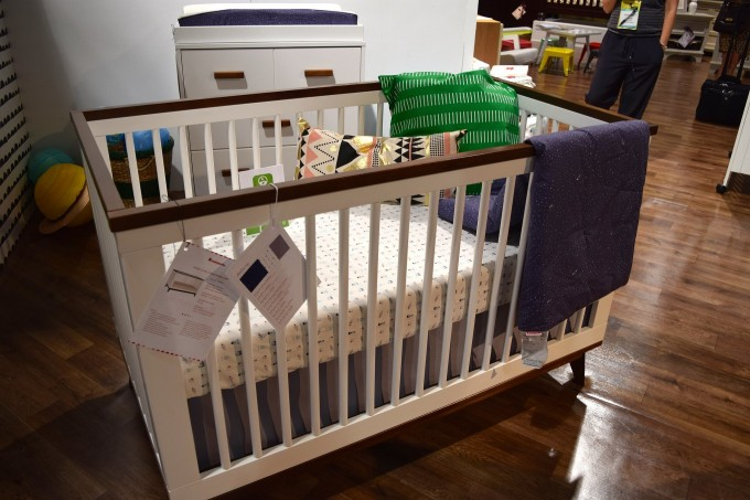 Charming Crib By Babyletto On Wooden Floor Matched With White Wall Plus White Wooden Cabinet For Nursery Decor Ideas