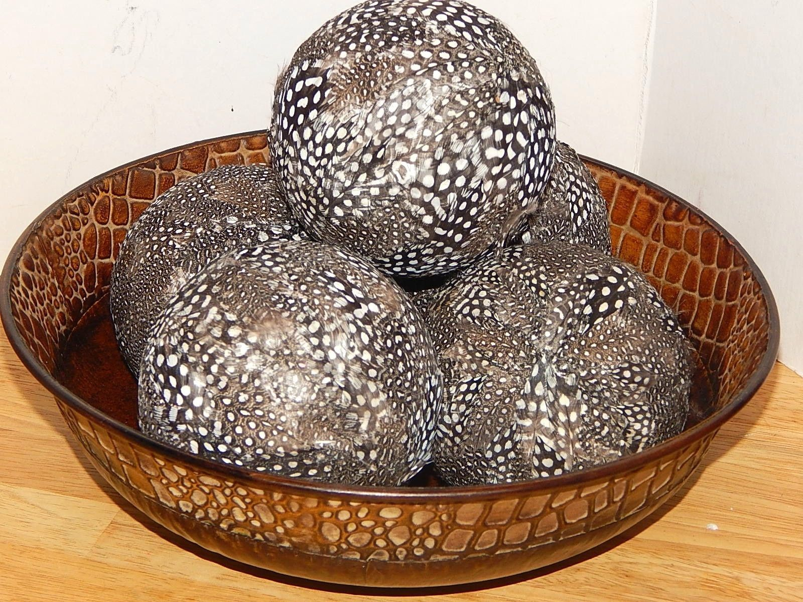 charming decorative orbs with black dotted on brown ceramic bowl for table accessories ideas