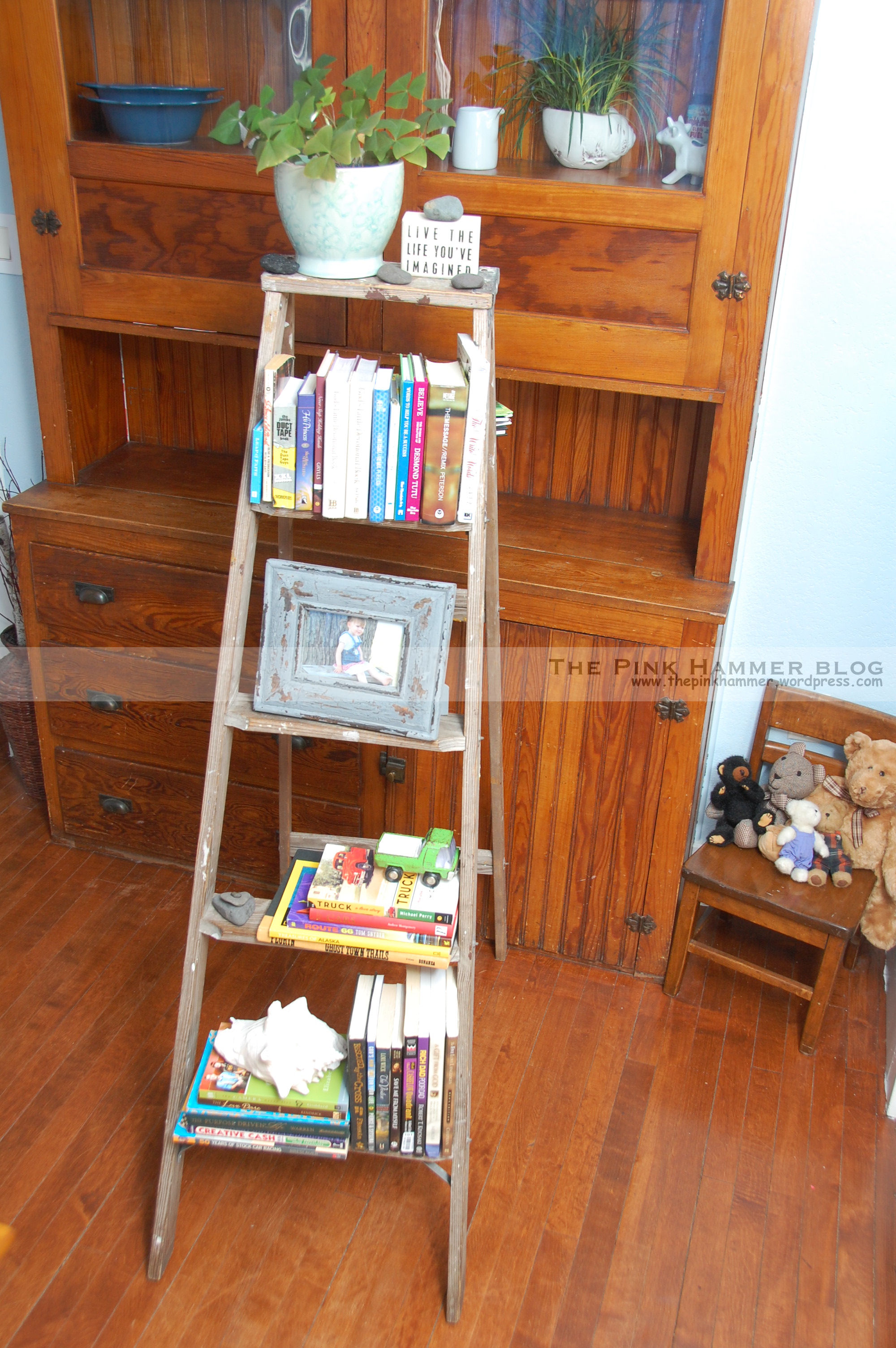 charming ladder bookshelf on wooden floor matched with blue wall plus wooden cabinet for home decor ideas