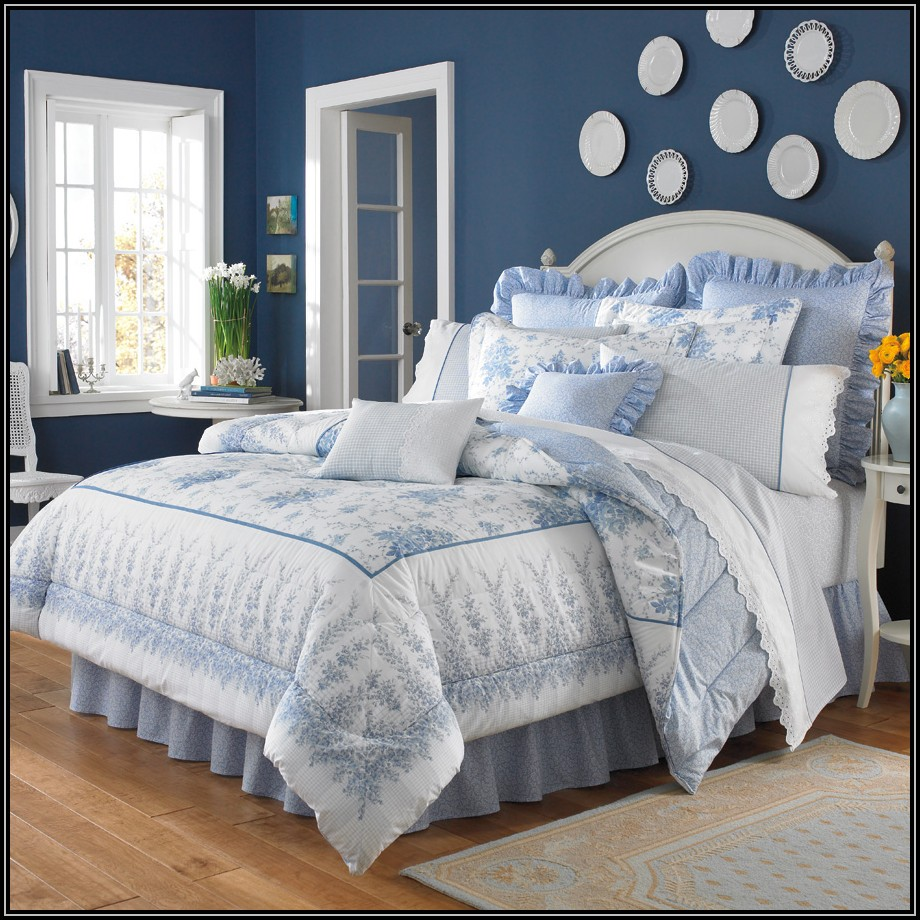 charming laura ashley bedding in blue and floral pattern with white headboard plus pillows on brown wooden floor plus rug matched with blue wall plus white door and window for inspiring bedroom decor ideas