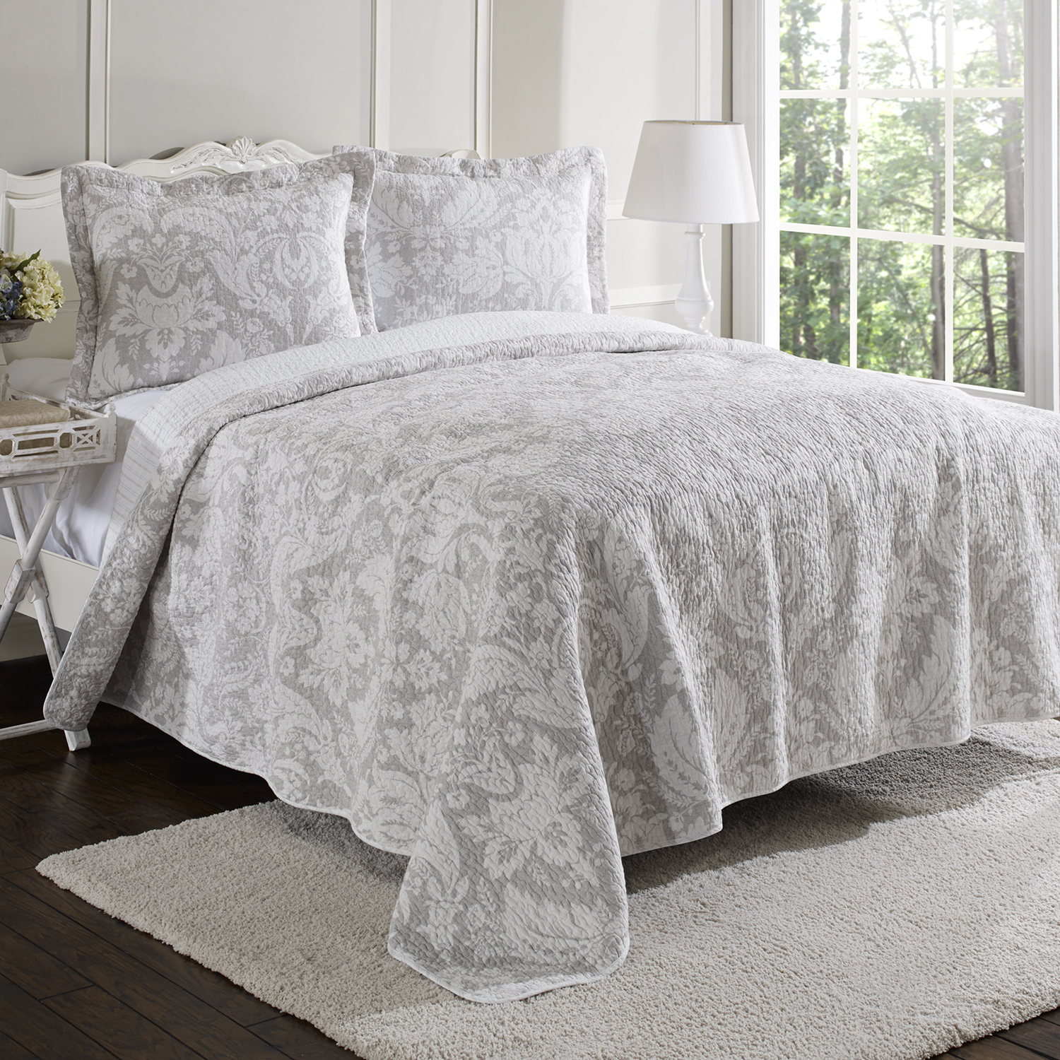 charming laura ashley bedding in grey and white floral pattern with white headboard on wooden floor plus white rug matched with white wall plus white table standing lamp for bedroom decor ideas