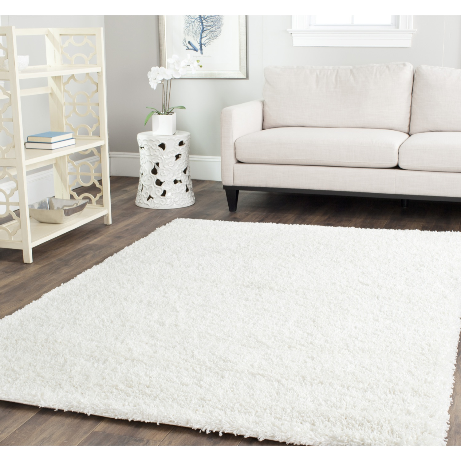 charming square shag rugs in white on wooden floor plus white sofa and antique white rack for living room decor ideas