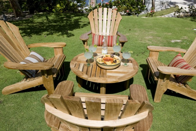 Charming Teak Adirondack Chairs Plus Round Teak Table For Inspiring Outdoor Dining Room Decor Ideas