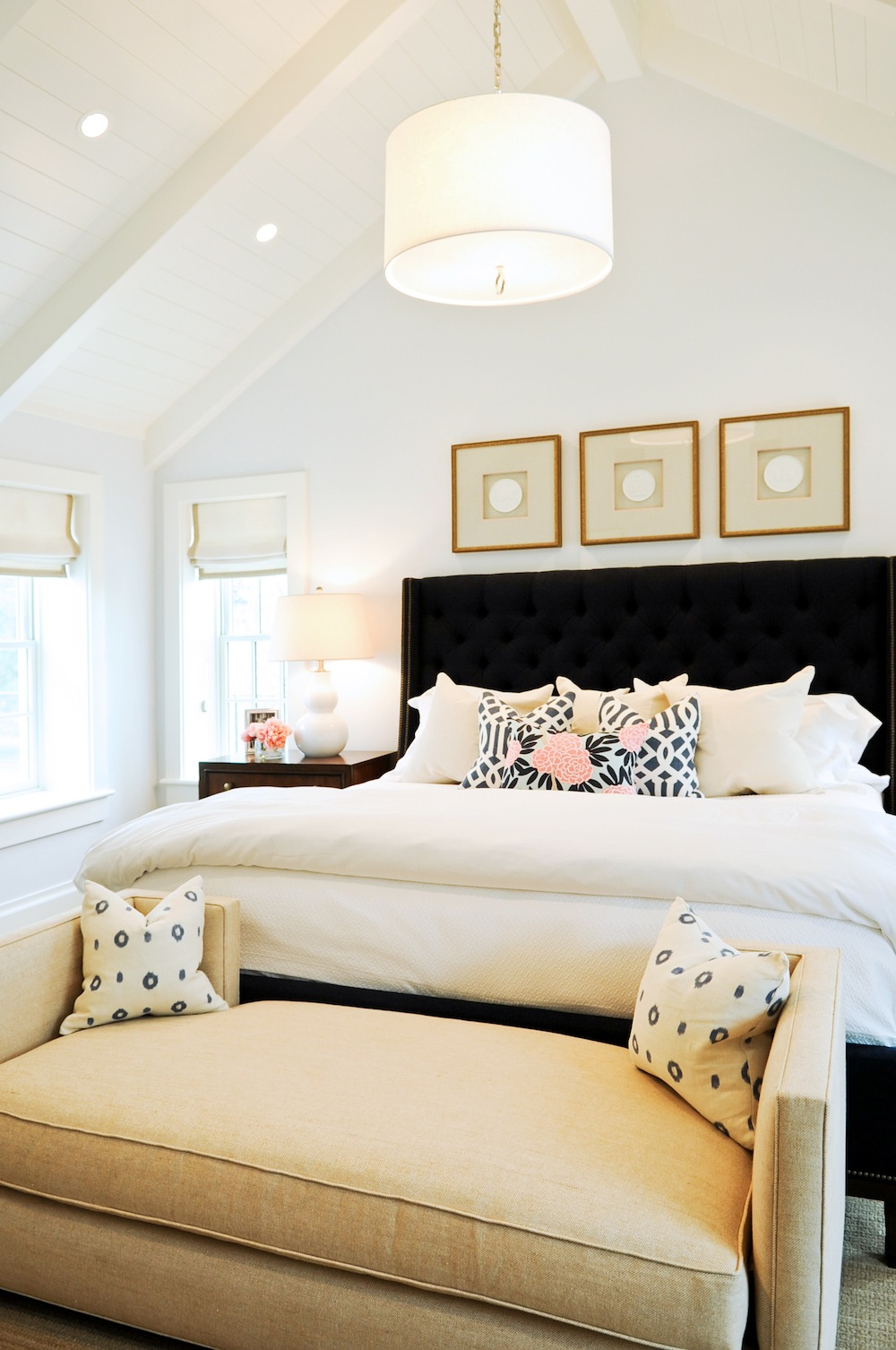 charming upholstered headboards in black with white bedding before the white wall plus chandelier for bedroom decor ideas