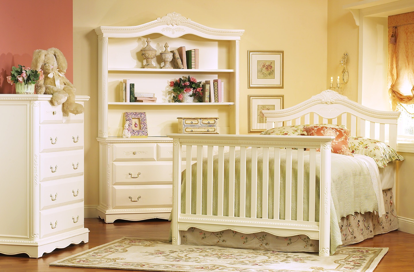 charming white munire crib on wooden floor plus white floral carpet plus white vanity before the cream wall for nursery decor ideas