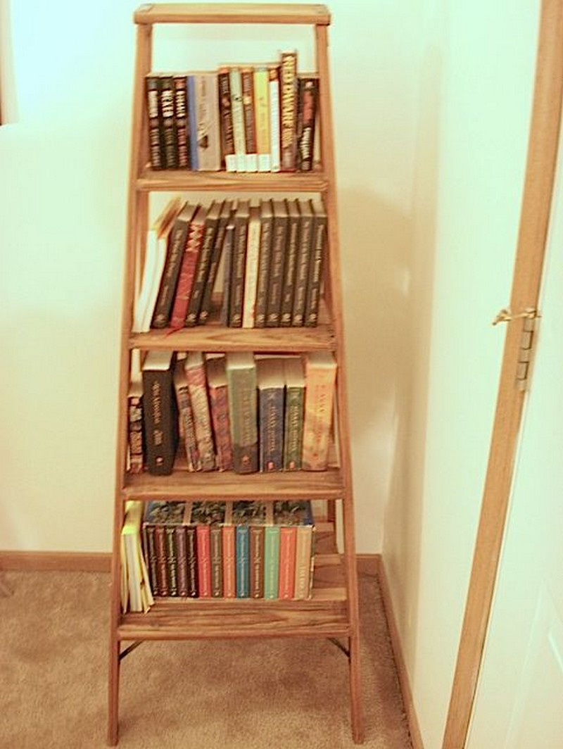 charming wooden ladder bookshelf with many books on wooden floor matched with white wall for home decor ideas