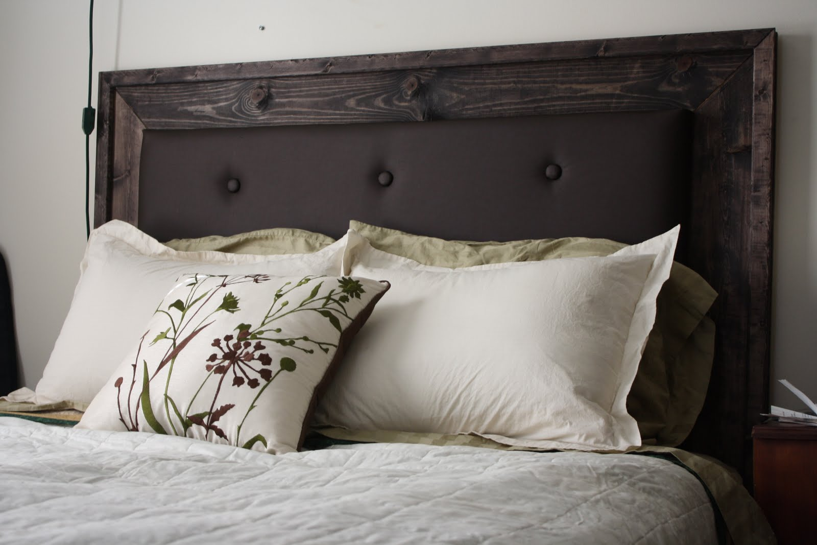 charming wooden upholstered headboards with brown tufted linen plus white bedding plus pillow for bedroom furniture ideas