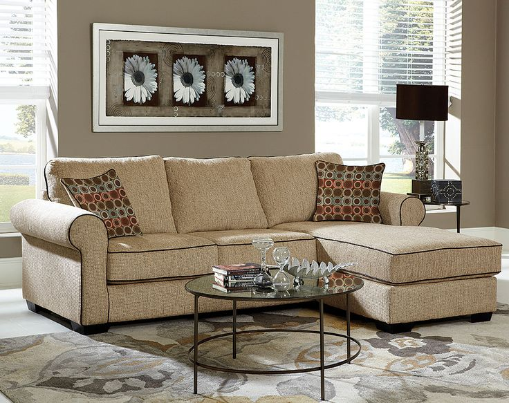 cheap sectional sofas in cream plus cushions on white ceramics floor plus carpet and round glass table for living room decor ideas