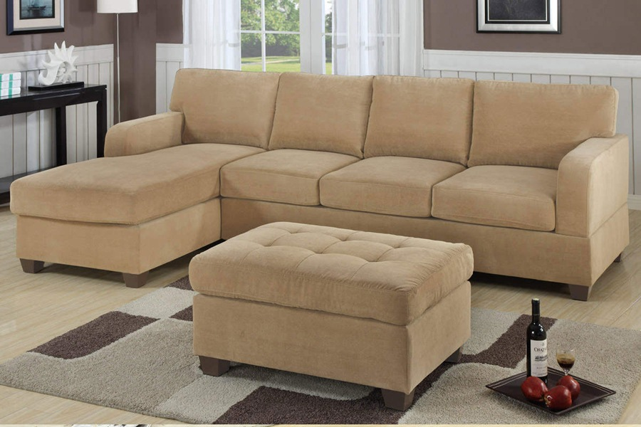 cheap sectional sofas in cream plus matching ottoman on wooden floor plus carpet for living room decor ideas