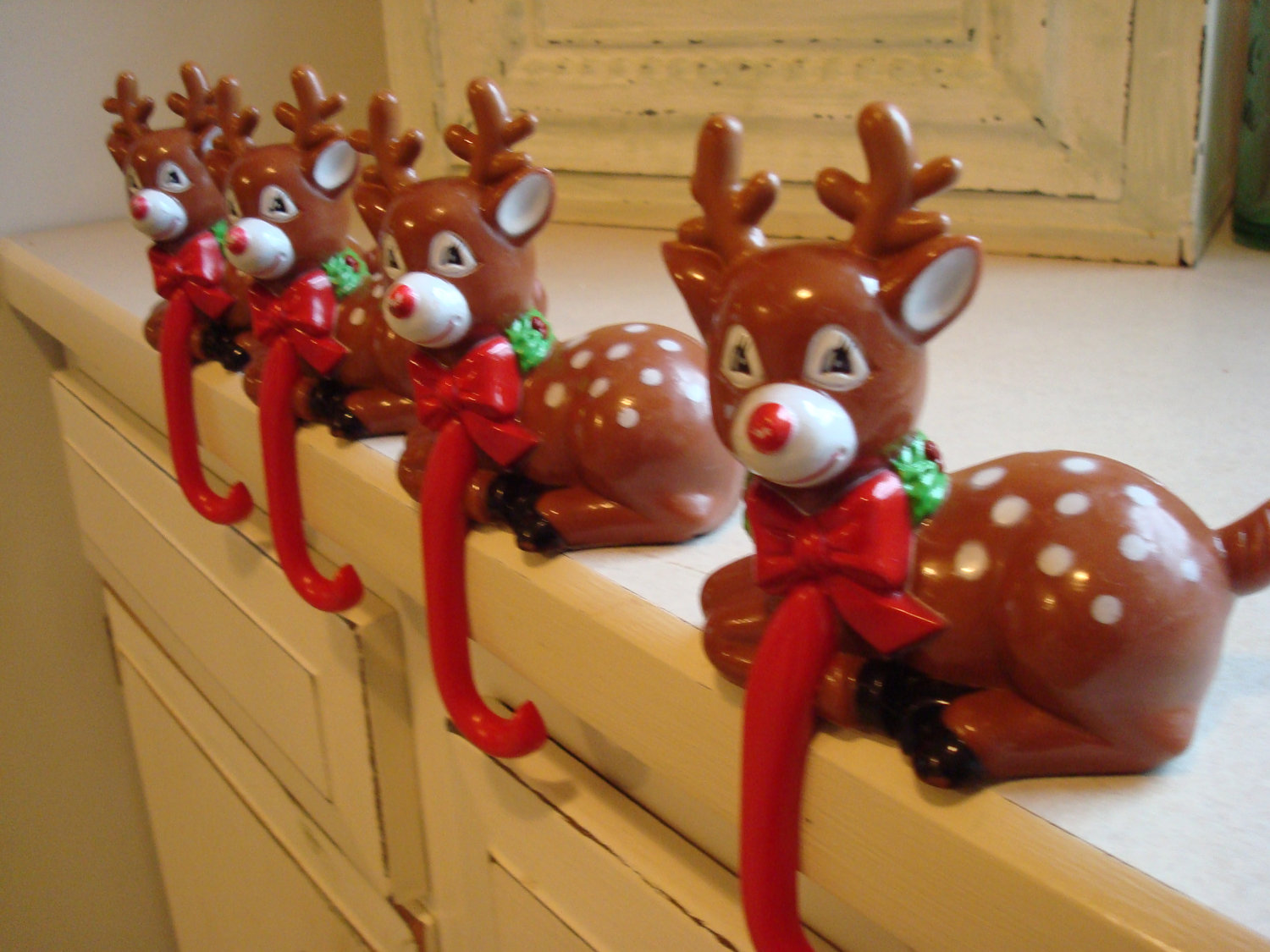 chic christmas stocking hanger in red deer ribbon design on white cabinet ideas