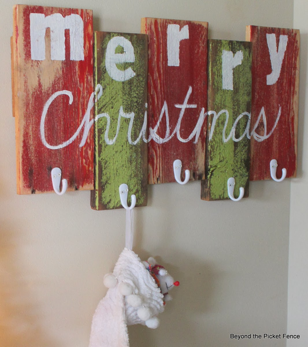 Chic White Christmas Stocking Hanger On Green And Red Painted Wood With Merry Christmas Text Ideas