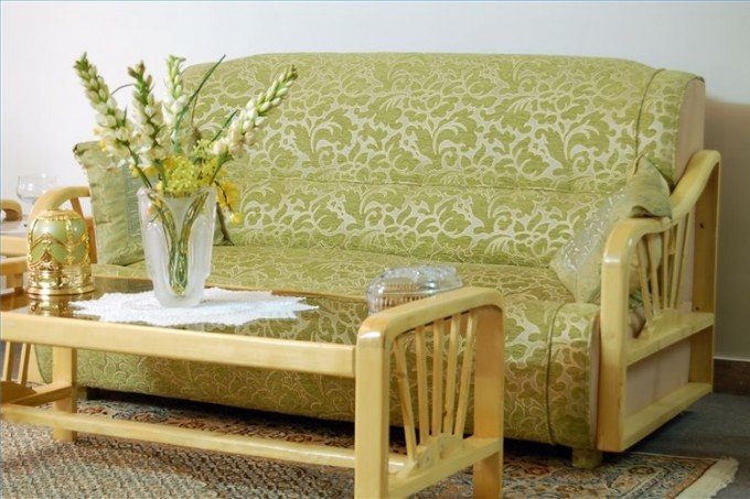 Comfortable Cheap Futons With Floral Pattern And Arm Plus Table For Living Room Furniture Ideas