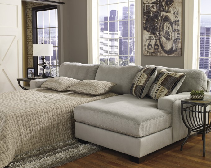 Comfortable Sectional Sleeper Sofa In Grey With Cushion On Wooden Floor Matched With Grey Wall For Living Room Decor Ideas