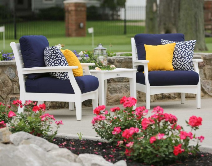Comfortable Sunbrella Cushions In Navy On White Sofa Plus White Wooden Table Plus Charming Plants For Awesome Outdoor Living Room Decor Ideas