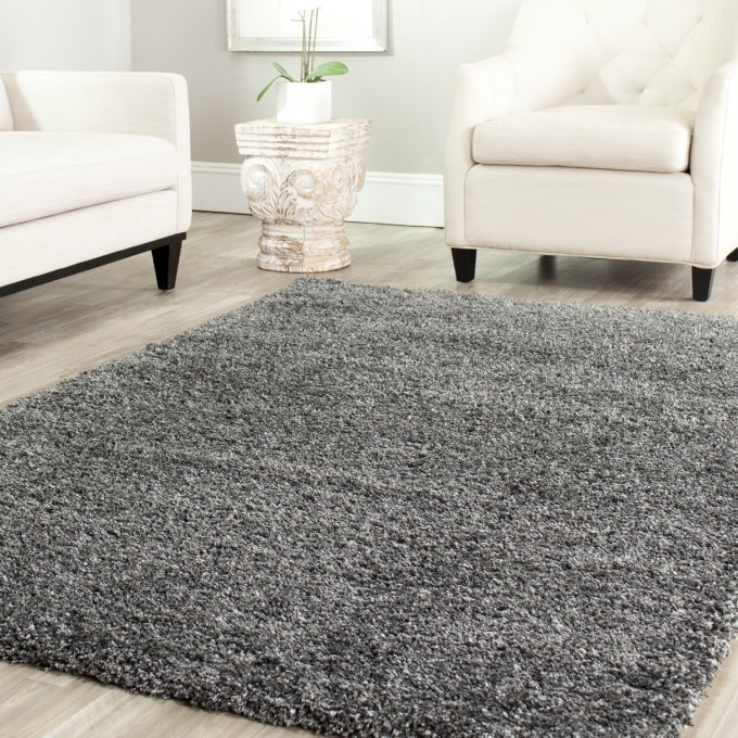 Cozy Solid Dark Grey Shag Rugs On Cream Wooden Floor Plus White Sofa Set Matched With White Wall For Living Room Decor Ideas