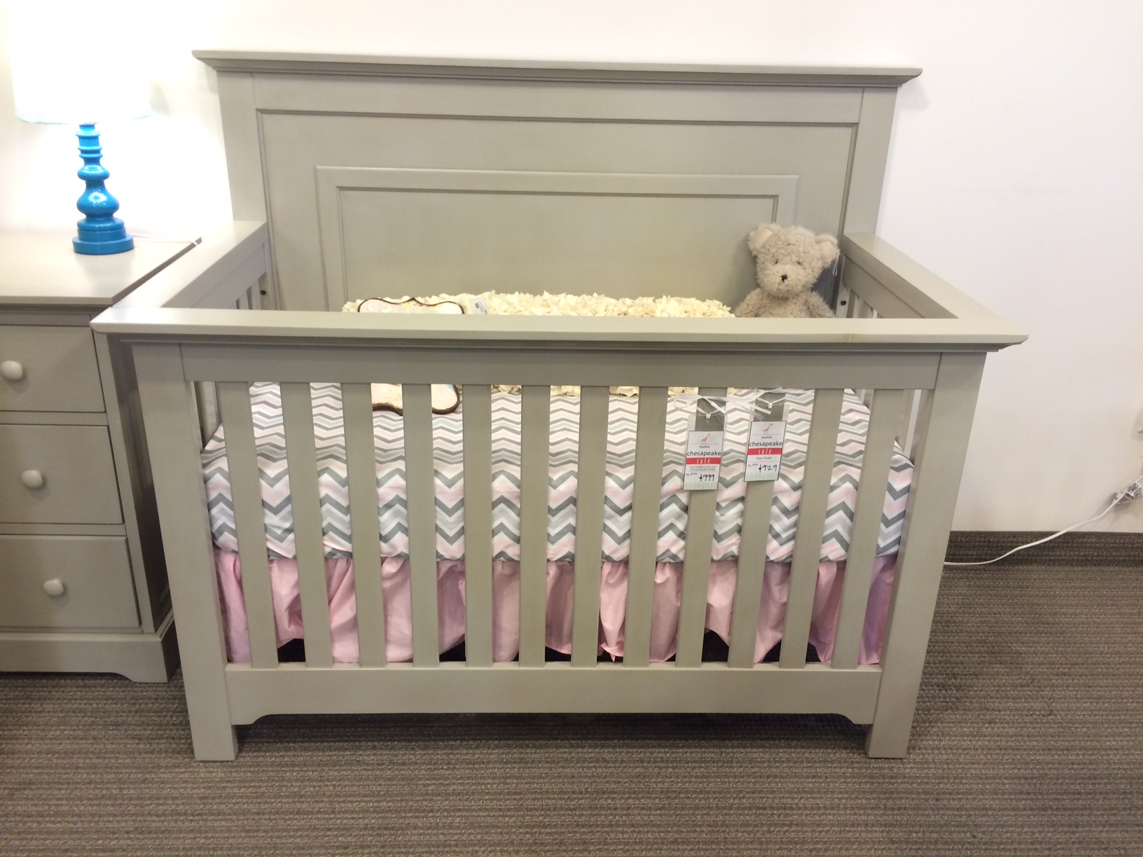 crib in dark gray by munire crib with chevron mattress on tan carpet matched with white wall plus dark gray dresser for nursery decor ideas