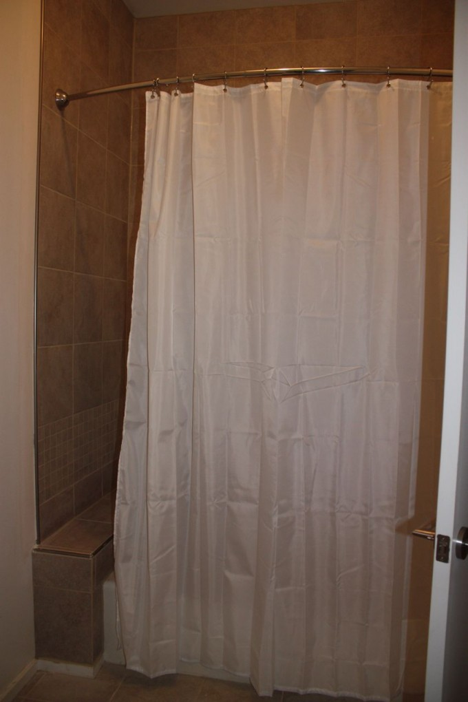 Curved Shower Curtain Rod With White Curtain And Tan Ceramics Floor For Bathroom Decor Ideas