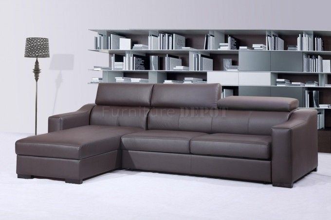 Dark Brown Leather Sectional Sleeper Sofa On White Ceramics Floor Plus Bookcase Filled With Books For Living Room Decor Ideas