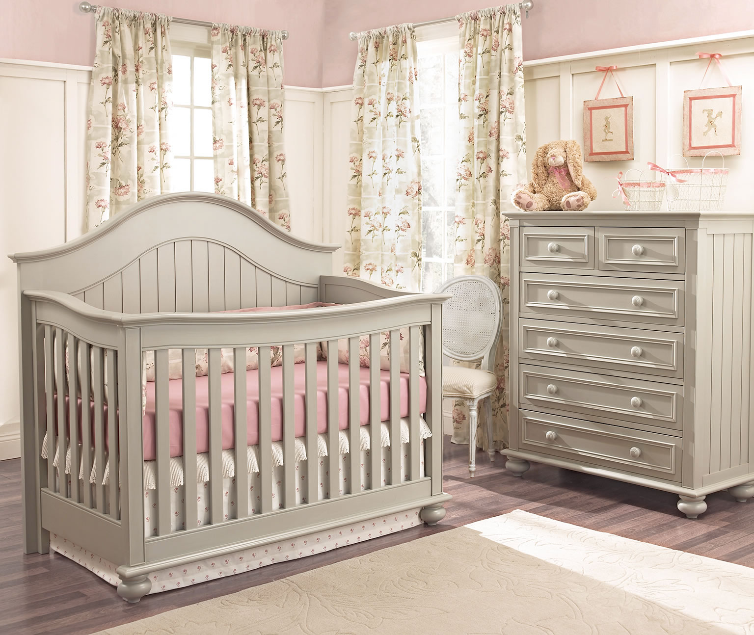 Dark Grey Wooden Munire Crib With Pink Bedding On Wooden Floor Plus White  Carpet Plus Dresser