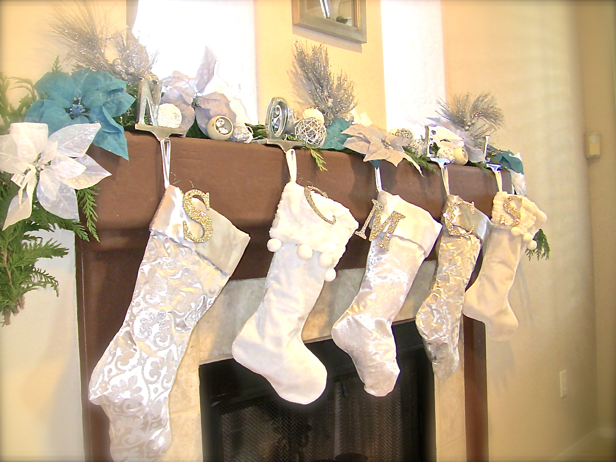Decorative Christmas Stocking Hanger With White Shocks On Wooden Fireplace Mantel Kit For Christmas Decoration Ideas