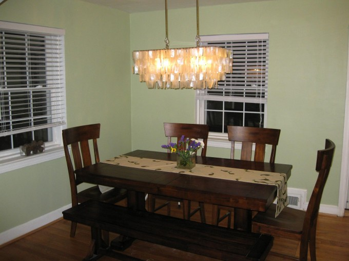 Dining Room Decor With Dining Table Set On Wooden Floor Matched With Green Wall With Window And Bali Blinds Plus Chandelier Ideas