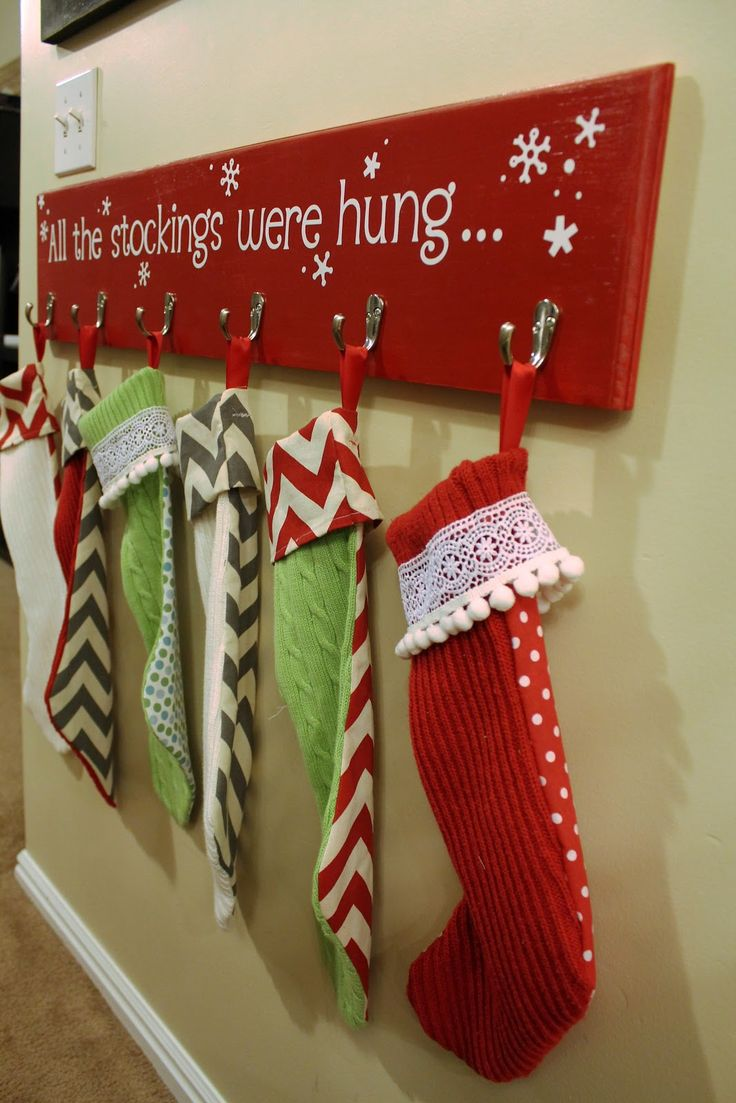 diy christmas stocking hanger on red wood with words for chrestmas decoration ideas