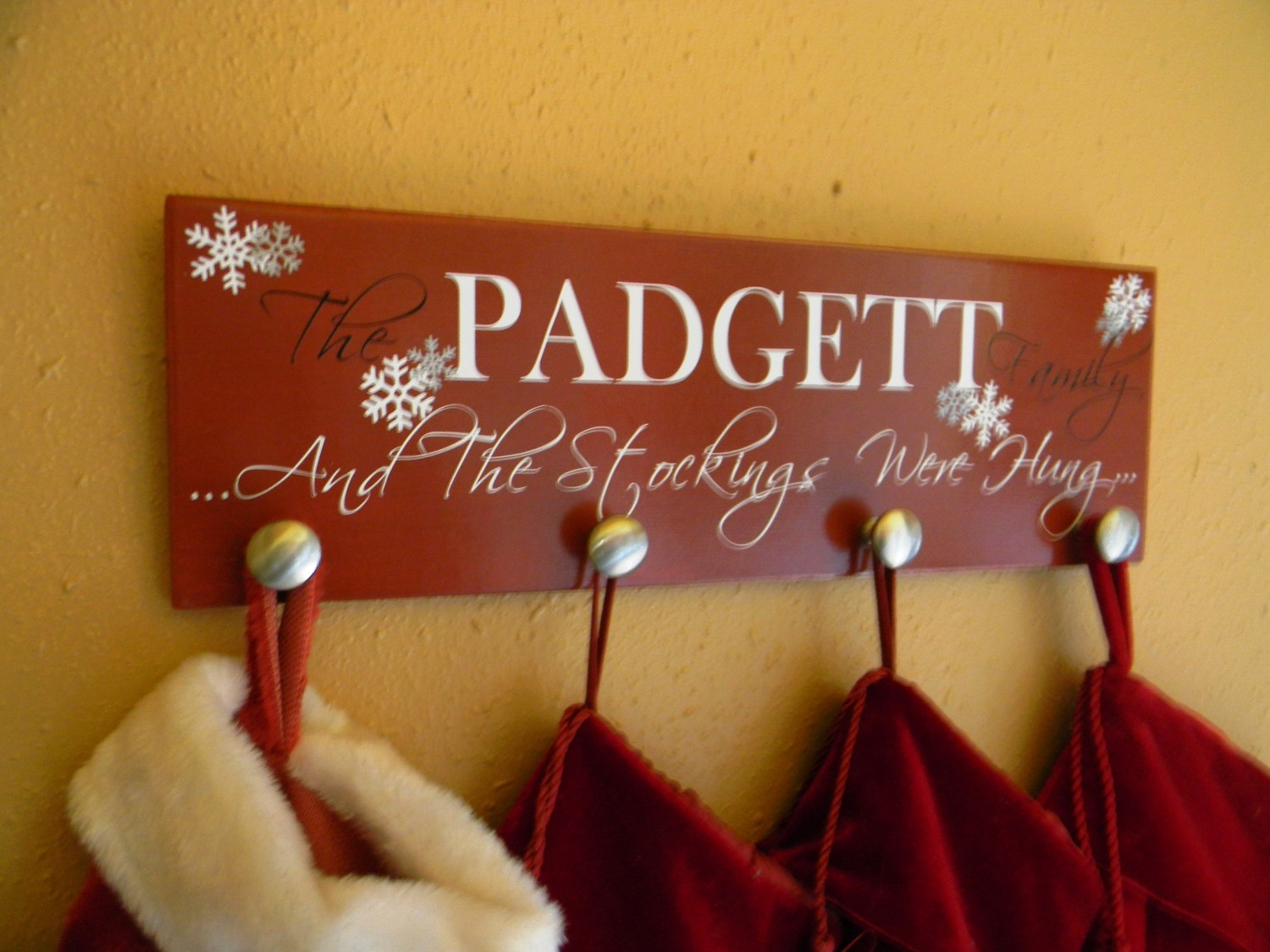 diy christmas stocking hanger with red background made of wood for christmas decoration ideas