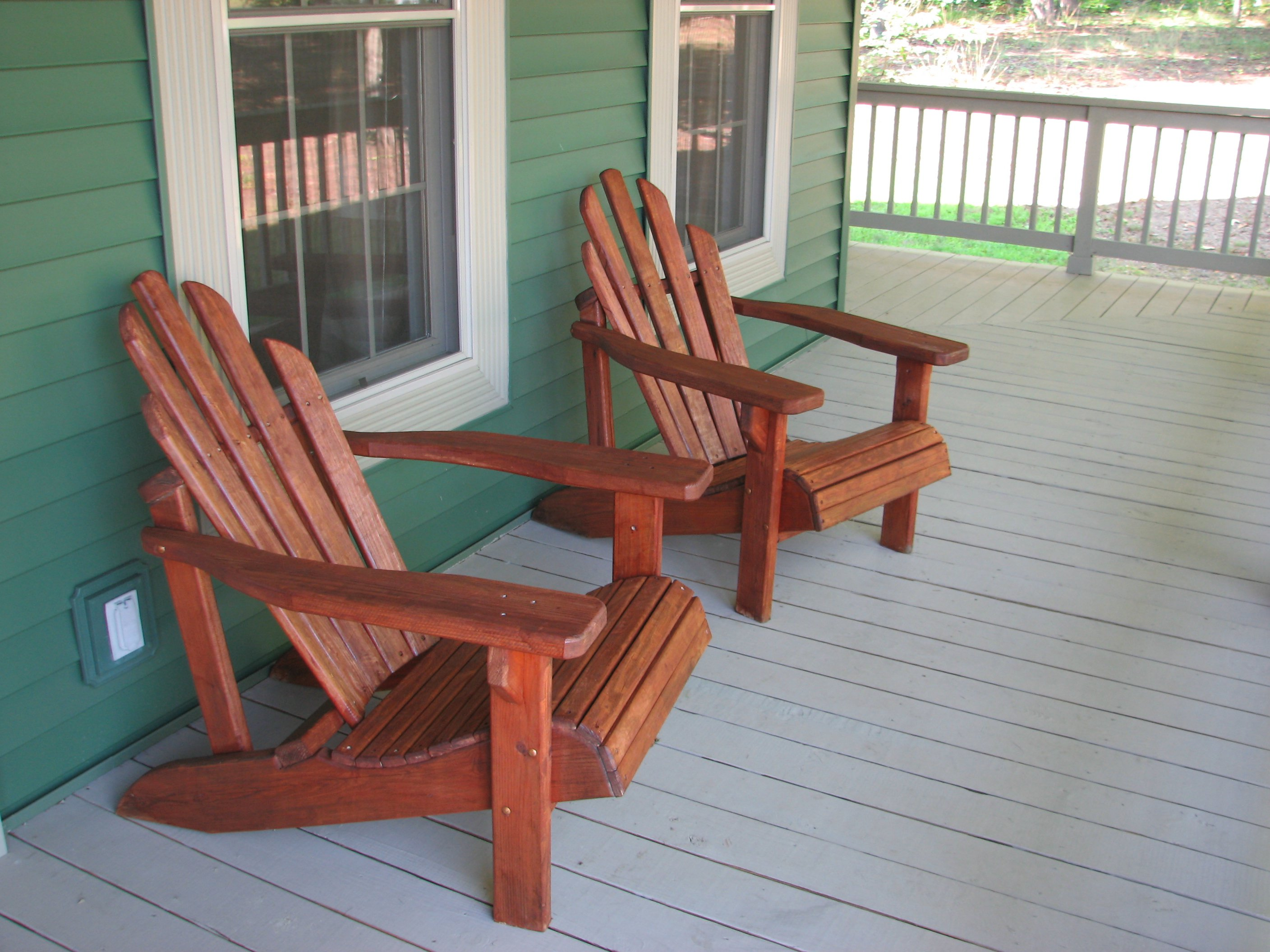 Double Teak Adirondack Chairs On Wheat Deck Matched With Green Wall For  Exterior Decor Ideas